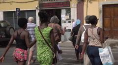 Praia, Cape Verde Islands, people cross the street Stock Footage