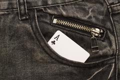 Ace card inside gray jeans pocket with zip lock Stock Photos