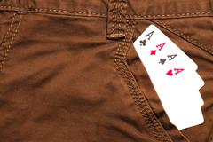 Four ace cards inside brown jeans front pocket Stock Photos