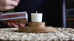candle being lit closeup - stock footage