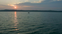 Fisherman in a boat on the river on the amazing evening dawn - stock footage