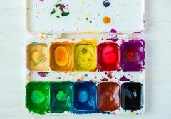 Artist brush and paint Stock Photos