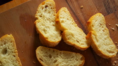 Slices of bread in the table Stock Footage