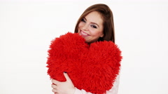 Woman gorgeous girl holding red heart love symbol 4K Stock Footage