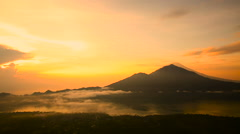 Sunrise over Lake Batur, Volcano Agung and Abang on the background. Bali - stock footage