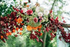 Flowers adorn the wedding ceremony - stock photo