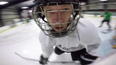 helmet cam hockey player skating around in the game neat angle - stock footage