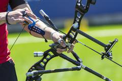 Bow shooting hands only - stock photo