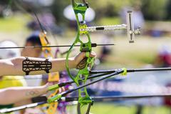Recurve bow archery competition hand only Stock Photos