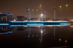 Tower cranes night view from the waterfront Admiral Lazarev Stock Photos