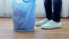 woman tying bag with garbage in waste bin - stock footage
