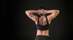 Fitness woman showing her back muscles Stock Footage