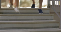 Two people running downstairs to have outdoor training Stock Footage