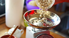 Pouring bean on the weight, super slow motion Stock Footage