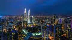 Beautiful and dramatic blue hour with pan view of Kuala Lumpur skyline, Malaysia - stock footage