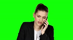 Businesswoman under stress speaking at the phone. Green screen - stock footage