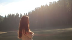 Mystic young girl with long dark hair at the mysterious mountain lake Synevir in - stock footage