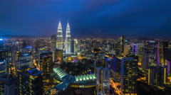Beautiful and dramatic blue hour zooming view of Kuala Lumpur skyline, Malaysia - stock footage