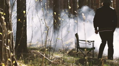 Chair costs in the wood of people has come and has sat down on him - stock footage