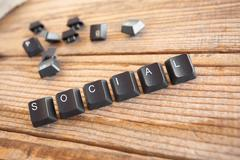 """social"" wrote with keyboard keys on wooden background - stock photo"