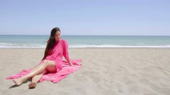 Graceful young woman sunbathing on the beach Stock Footage
