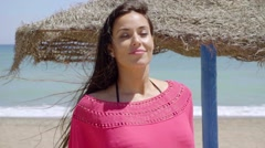 Pretty young woman on a resort beach in summer Stock Footage