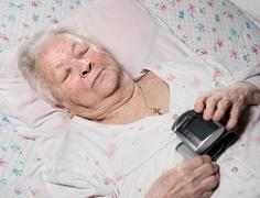 Old woman with arterial pressure measure - stock photo