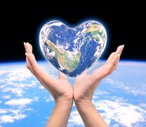 World in heart shape with over women human hands on blurred natural backgroun - stock illustration