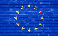 brexit blue european union EU flag on brick wall and one star with great brit - stock illustration