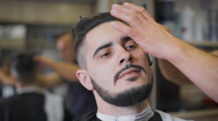 Hipster hairstyles in the salon. Professional barber uses a straight razor to Stock Footage