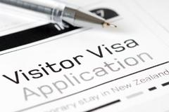 Visitor visa application form with pen Stock Photos