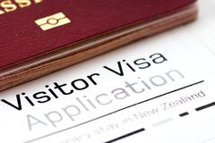 Visitor visa application form with passport Stock Photos