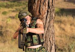 soldier with weapon - stock photo
