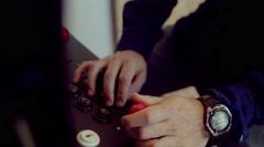 Man playing vintage videogame - stock footage