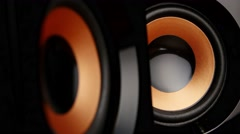 Speaker cone pumping to the sound of the bass. Closeup Stock Footage