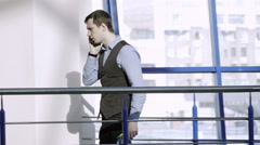 Young businessman talking his cellphone Stock Footage