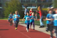 Young preschool children, running on track in a marathon competition Stock Photos