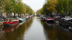 Zoom Out - Scenic Boats & Canals of Amsterdam Netherlands Stock Footage