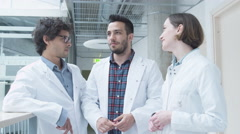 Group of Students of Medical School have Meeting in College Hallway. - stock footage