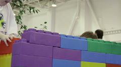 Children making the building of the large bricks Stock Footage