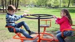 Happy children playing at playground - stock footage