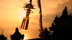 Traditional Penjor Decoration in Pura Uluwatu Temple at Sunset, Bali Indonesia Stock Footage