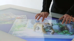 Hands using a business application on touch screen table panel. Stock Footage