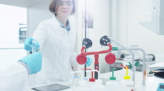 Team of Multiethnic Students in Coats Working in Laboratory - stock footage