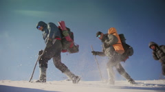 Hikers go through the snow in the mountains. Vignette color - stock footage