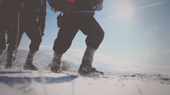 Close-up of  traveler`s Legs wandering in the snow in the mountains Stock Footage