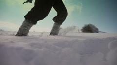 Walking through the deep snow. Indigo color Stock Footage