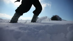 Walking through the deep snow. More contrast Stock Footage