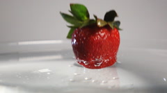 Strawberry plung into the water Stock Footage