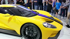 Ford GT, yellow supercar at New York International Auto Show Stock Footage